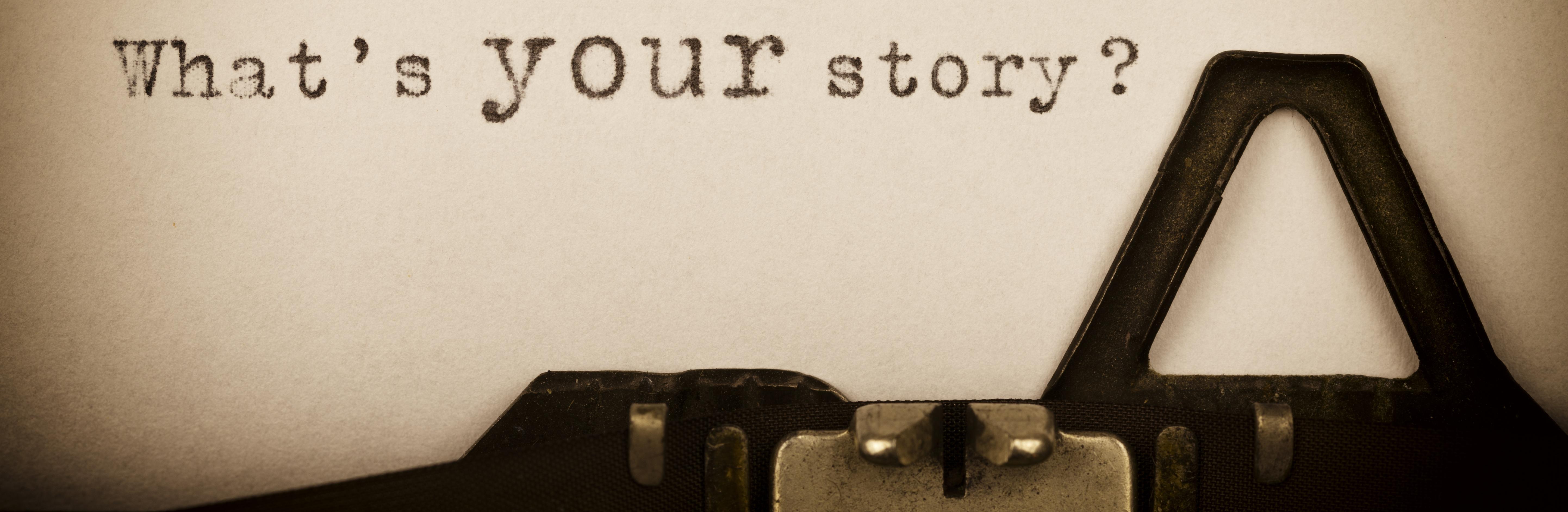 What's your story-Schriftzug mit einer Schreibmaschine geschrieben